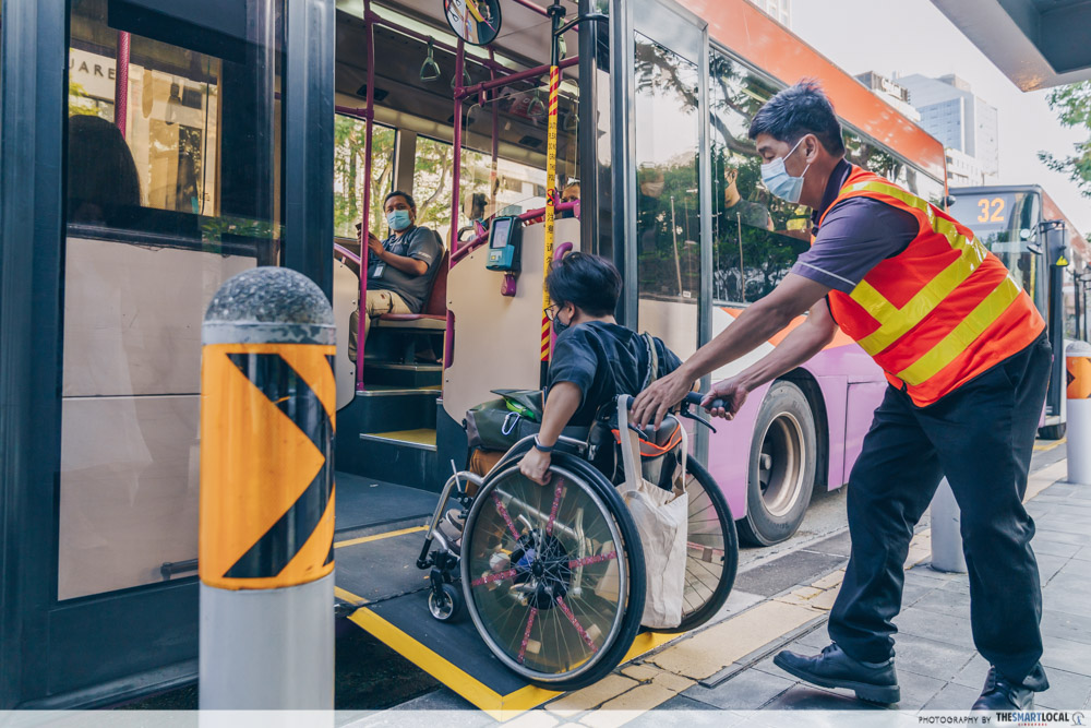 bus driver in singapore assisting wheelchair user board bus