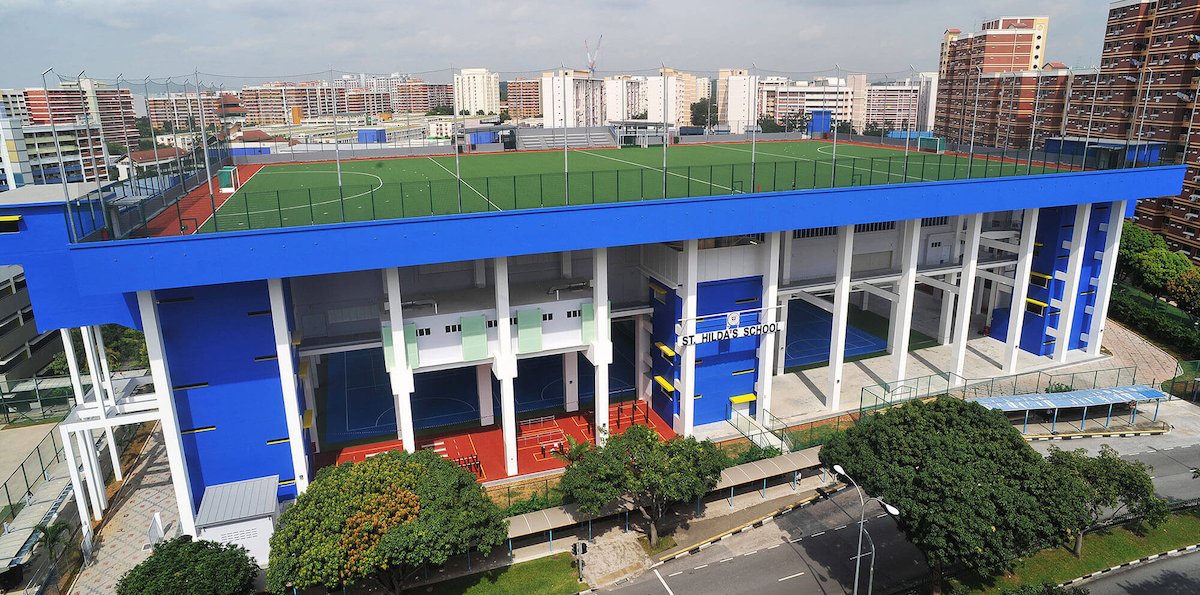 coolest schools in Singapore - st hildas secondary school rooftop hockey pitch and indoor sports halls