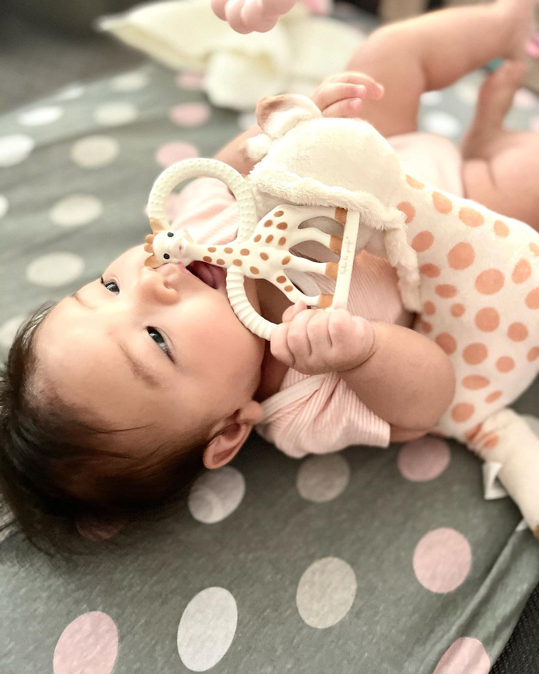 Baby using with Sophie La Giraffe teethers