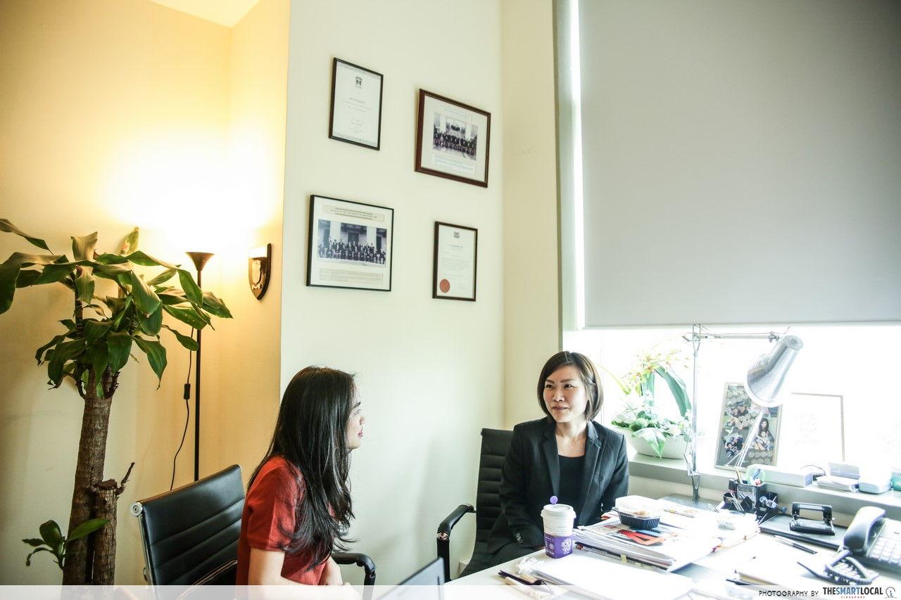Adoption in Singapore - Woman talking to lawyer