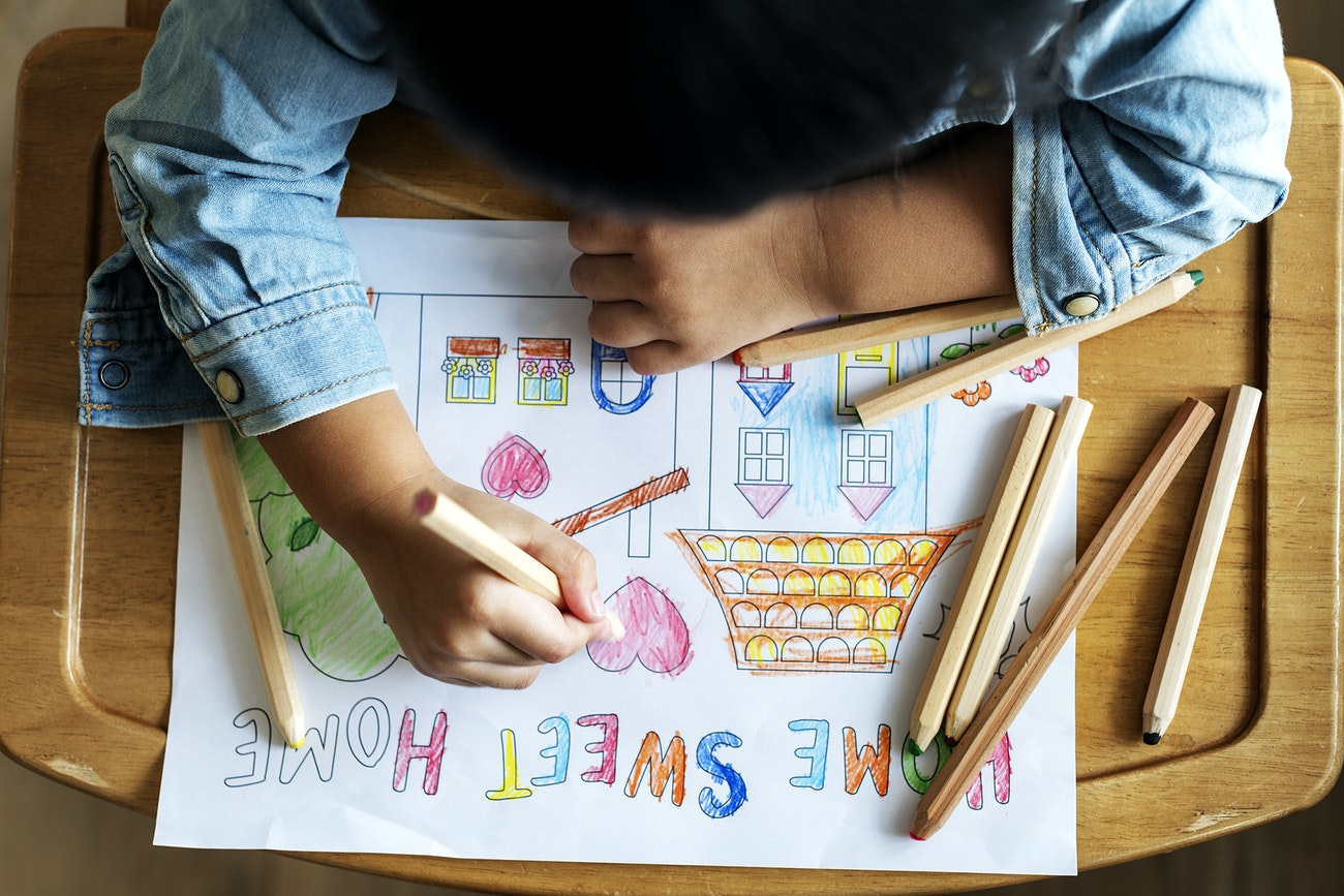 Child colouring on paper