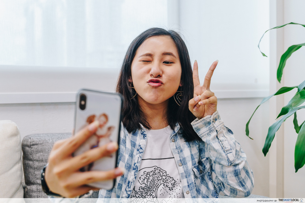 Pouty Selfie Taking With Phone - Dating App Mistakes