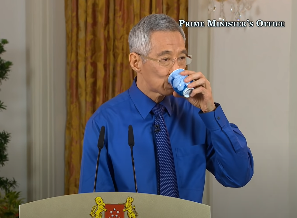 pm lee magic cup and blue shirt