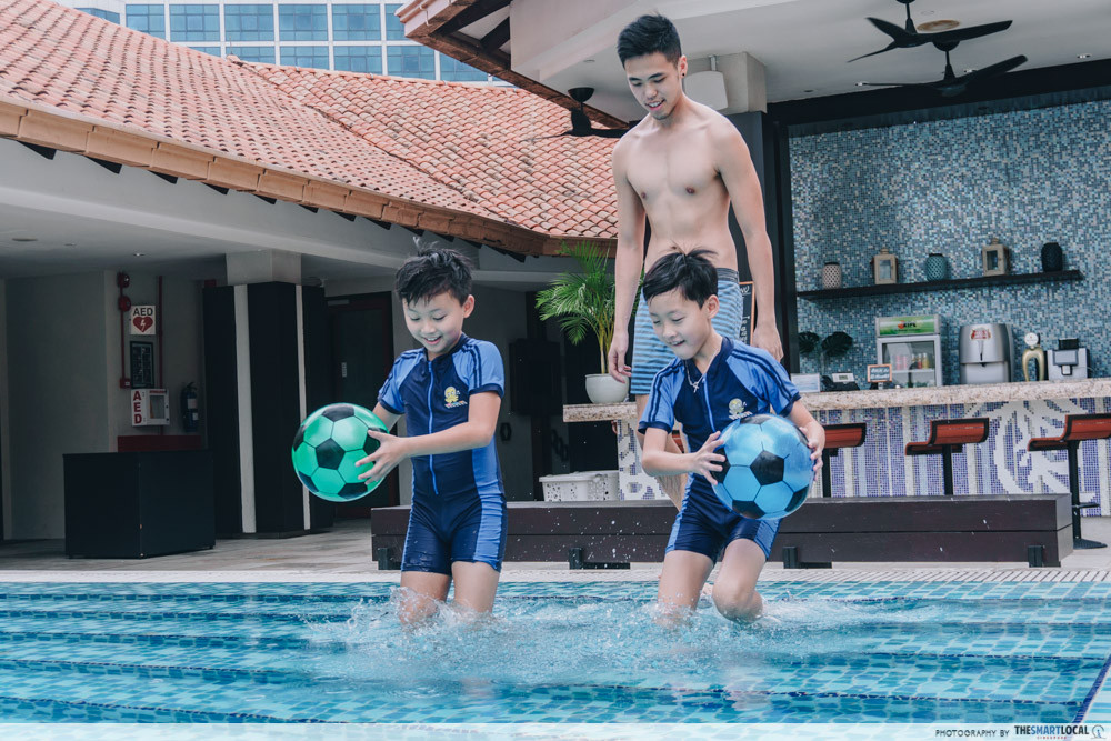 Dad with kids at swimming pool