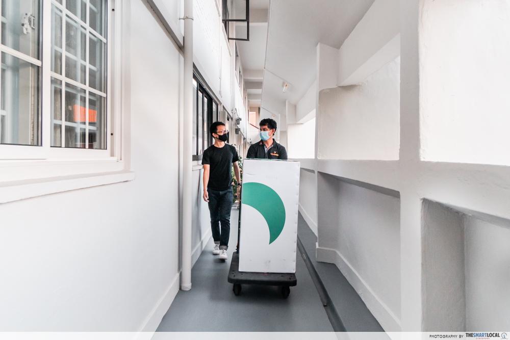 delivery man walking along corridor