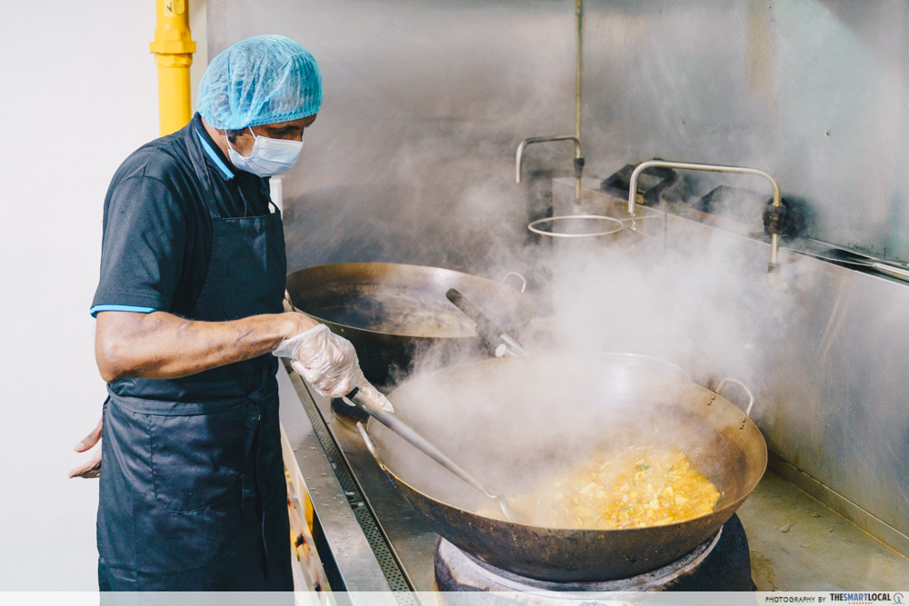 chef cooking curry dish