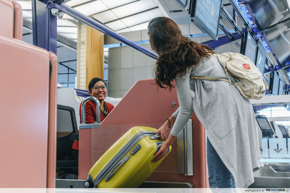 Girl checking in baggage