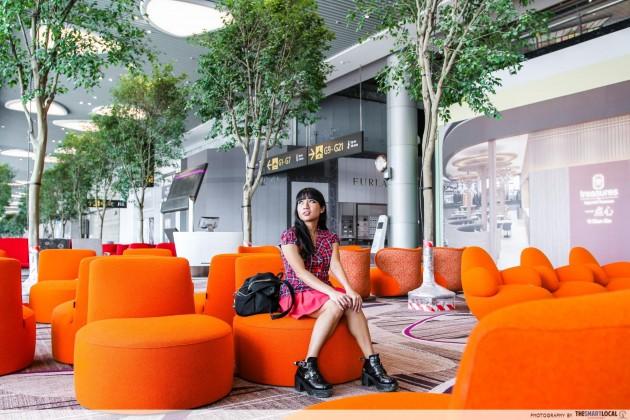 Girl sitting at Changi Airport terminal