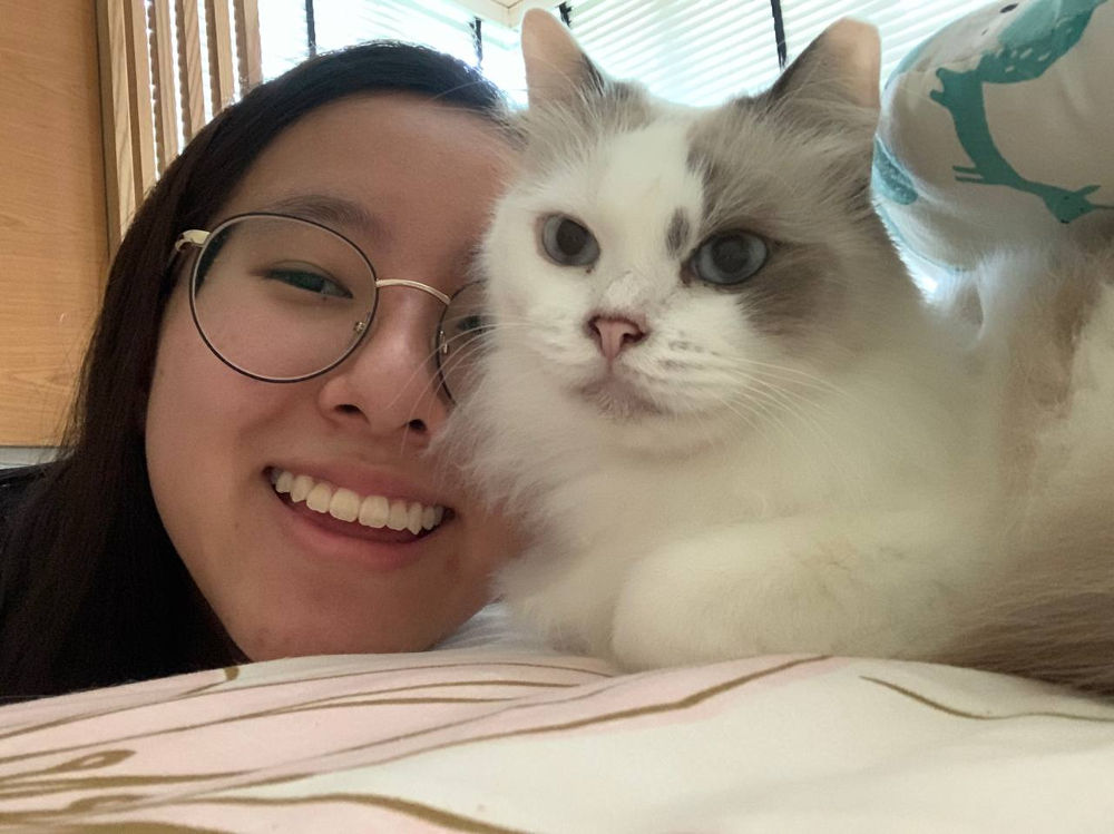 Singapore pets - selfie of girl with cat