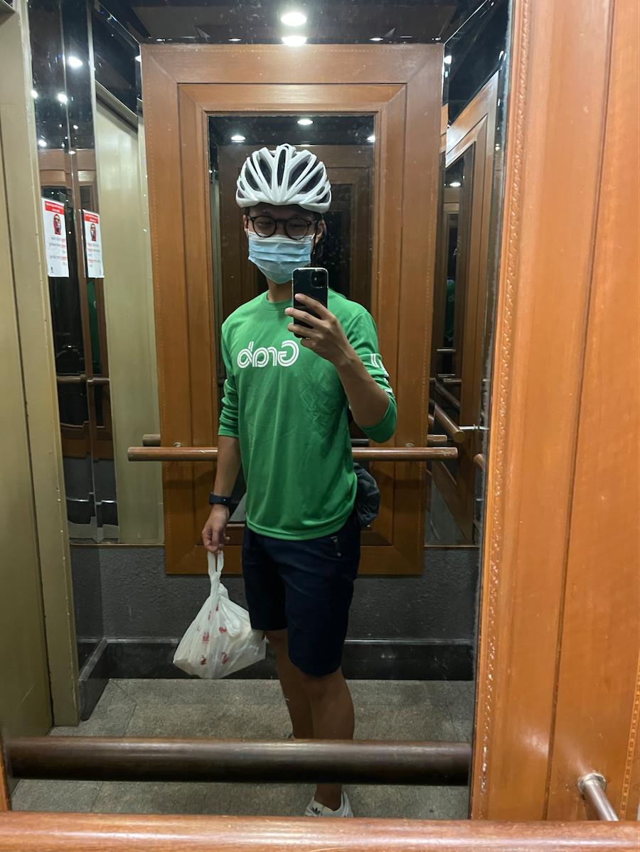 grabfood rider - delivering in condo lift