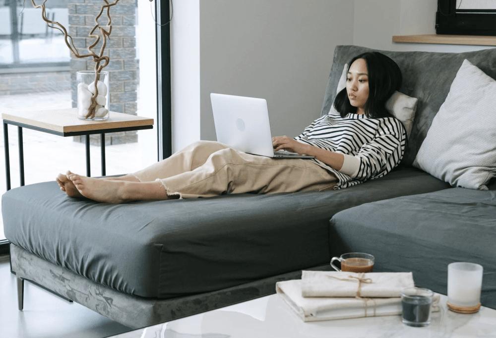 WFH laptop on sofa - work burnout in singapore